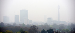 © Licensed to London News Pictures. 03/04/2014. London, UK Views of central London shrouded in smog this morning 3rd April 2014 from Primrose Hill. Photo credit : Stephen Simpson/LNP