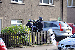Police Scotland officers in riot gear and units from the local fire station attended a seige in a house in Lomond Crescent Dunfermline while neighbours look on from their windows<br /> <br /> (c) David Wardle   Edinburgh Elite media