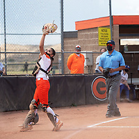 Gallup Bengals catcher Steph Charlie (12) catches a foul ball for an out against the Bloomfield Bobcats Friday afternoon at Gallup High School in Gallup.