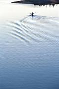 Kayaker paddling at sunset Megunticook Lake, Maine.
