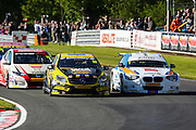 Adam Morgan and Sam Tordoff battle it out to the first turn during the Dunlop MSA British Touring Car Championship at Oulton Park, Budworth, Cheshire, United Kingdom on 7th June 2015. Photo by Aaron Lupton.