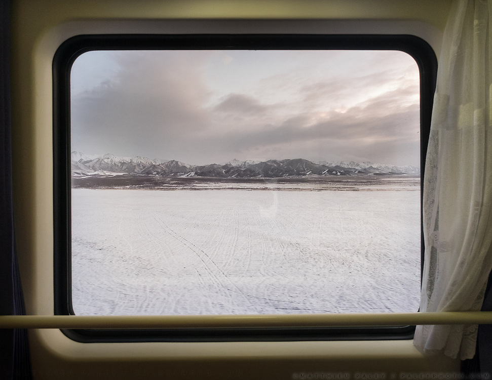 The wide snowy expanse past Xining, in Qinghai province in central China, by the Tibetan Plateau. Life in the train from Hong Kong to Urumqi, Xinjiang.