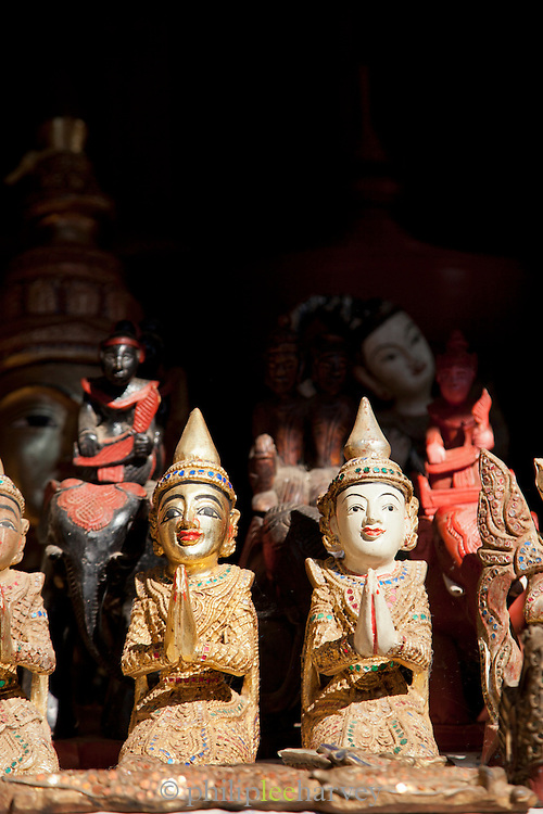 Small carved statues for sale at a market in the Shwe In Dein pagoda complex near Inle Lake, Myanmar