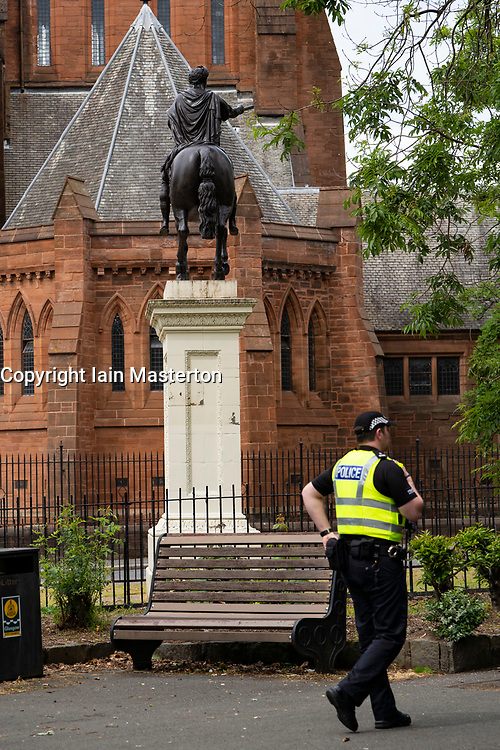 Glasgow, Scotland, UK. 12 June 2020. Police patrolling George Square in the city centre to deter protestors from vandalising the historical statues found there. Following the recent Back Lives Matter demonstrations many statues of people with alleged links to slavery or colonialism have been targeted with graffiti.  Iain Masterton/Alamy Live News