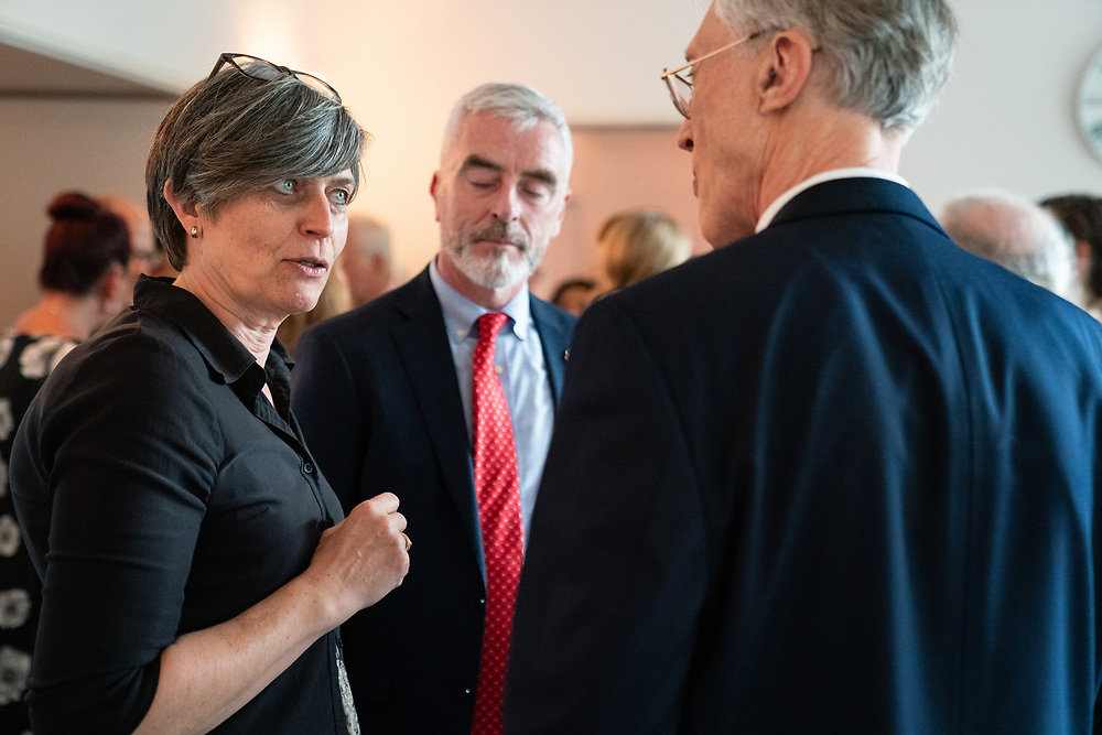 The Ambassador of Denmark to the USA during a reception with a physics association. The man on the far right is a Nobel Laureate in Physics.