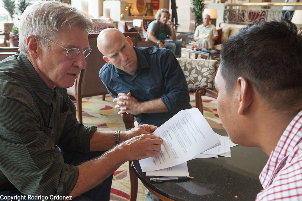 (From left to right) Actor and environmental activist Harrison Ford, Co-Executive Producer Solly Granatstein, and Greenpeace Indonesia's forest campaigner Bustar Maitar discuss interview details in Jakarta, Indonesia. <br /> Harrison Ford visited Indonesia to learn more about deforestation, as one of the correspondents for Showtime's new documentary series about climate change Years of Living Dangerously.