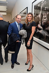 GEORGE & CHRISTINA GOULANDRIS at a private view of photographs by wildlife photographer David Yarrow included in his book 'Encounter' held at The Saatchi Gallery, Duke of York's HQ, King's Road, London on 13th November 2013.