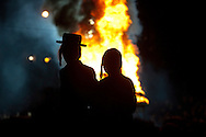 An estimated 70,000 members of an ultra-Orthodox Jewish community attend a bonfire celebration marking the Jewish holiday of Lag Baomer, Saturday, May 17, 2014 in Kiryas Joel, N.Y. Local organizers say it is the largest such celebration in the United States.