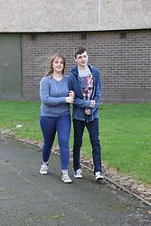 Teenage couple walking arm in arm