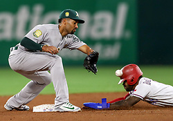 April 23, 2018 - Arlington, TX, U.S. - ARLINGTON, TX - APRIL 23: Texas Rangers center fielder Delino DeShields sides into second base as Athletics shortstop Marcus Semien tries to make the catch during the game between the Texas Rangers and the Oakland Athletics on April 23, 2018 at Globe Life Park in Arlington, Texas. (Photo by Steve Nurenberg/Icon Sportswire) (Credit Image: © Steve Nurenberg/Icon SMI via ZUMA Press)