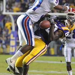 14 November 2009:  La. Tech safety, #31 Chad Boyd, delivers a crushing hit on LSU wide receiver, #80 Terrance Toliver, during a game between in state rivals Louisiana Tech Bulldogs and the #8 ranked LSU Tigers being played at Tiger Stadium in Baton Rouge, Louisiana.  LSU would win 24-16...Mandatory Credit: Stacy Revere / Southcreek Global