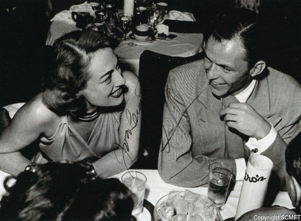 1948 Joan Crawford and Frank Sinatra chat at Ciro's Nightclub