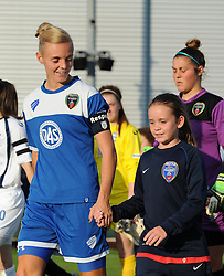 Sophie Ingle of Bristol Academy Women and mascot make their way on to the pitch at Stoke Gifford Stadium - Mandatory by-line: Paul Knight/JMP - Mobile: 07966 386802 - 05/09/2015 -  FOOTBALL - Stoke Gifford Stadium - Bristol, England -  Bristol Academy Women v Birmingham City Ladies FC - FA Women's Super League