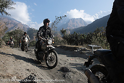 Corey Froschheuser with the Annapurna Range in the background on Day-7 of our Himalayan Heroes adventure riding from Tatopani to Pokhara, Nepal. Monday, November 12, 2018. Photography ©2018 Michael Lichter.