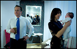 The Prime Minister David Cameron in the Green room with his wife Samantha and his baby daughter Florence, after delivering his speech to the Conservative Party Conference in Birmingham, Wednesday October 6, 2010. Photo By Andrew Parsons / i-Images.