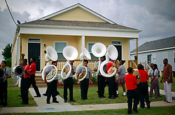 29 August 2014. Lower 9th Ward, New Orleans, Louisiana.<br /> Hurricane Katrina memorial 9 years later. <br /> The band from the Martin Luther King Jr Charter High School play outside a newly constructed Louisiana Housing Authority house opened on the 9th anniversary of the storm that devastated the region.<br /> Photo; Charlie Varley/varleypix.com