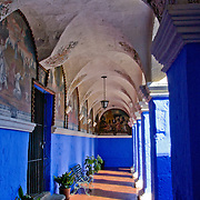 """Graceful archways of Monasterio Santa Catalina in the """"White City"""" of Arequipa, Peru."""
