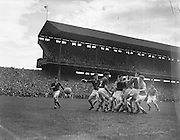 Group of players tackle for the ball during the All Ireland Minor Gaelic Football Final Meath v Armagh in Croke Park on the 21st September 1957.