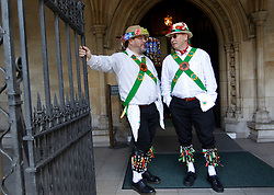 © Licensed to London News Pictures. 12/05/2012, London, UK.  Two Woodside Morris Men wait for their turn to dance outside the Westminster Abbey in London as Morris men from around the country gather in London for a Westminster Morris Men Day of Dance, Saturday, May 12, 2012. Photo credit : Sang Tan/LNP
