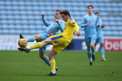 Coventry City's Luke Thomas and AFC Wimbledon's Tyler Garratt challenge for the ball during the Sky Bet League One match at the Ricoh Arena, Coventry
