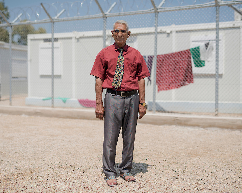 Abdulbaki Yunis, a Syrian Kurd refugee from Damascus in the First Reception Centre (Hot-Spot) of Leros, Greece. <br /> <br /> The Hot Spot in Lepida opened on the 26th of February 2016 in the grounds of the former Lepida psychiatric hospital.  At the beginning it served as a registration camp for refugees and migrants who were travelling to Europe through Greece but since the closure of the borders in March 2016 it serves as a permanent camp. People are allowed to go out, they have three meals a day, the prefabricated huts have a bathroom and are air-conditioned and compering to other refugee camps in Greece the conditions are bearable.