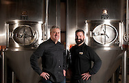 6 FEB. 2014 -- O'FALLON, Mo. -- Jim Gorczyca (left), president of O'Fallon Brewery, and brewmaster Brian Owens pose for a photograph at the company's facility in O'Fallon, Mo. Thursday, Feb. 6, 2014. The company is planning an expansion, according to Gorczyca, with a new brewery in Maryland Heights. Photo © copyright 2014 Sid Hastings.
