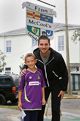 23 November 2015. Finn McCool's Irish Pub, New Orleans, Louisiana.<br /> Major League Soccer (MLS) star player Patrick Mullins of New York City FC poses for a photo with Ben.<br /> Photo©; Charlie Varley/varleypix.com