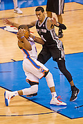 June 2, 2012; Oklahoma City, OK, USA; Oklahoma City Thunder guard Russell Westbrook (0) is guarded by San Antonio Spurs guard Danny Green (4) during a playoff game  at Chesapeake Energy Arena.  Thunder defeated the Spurs 109-103 Mandatory Credit: Beth Hall-US PRESSWIRE
