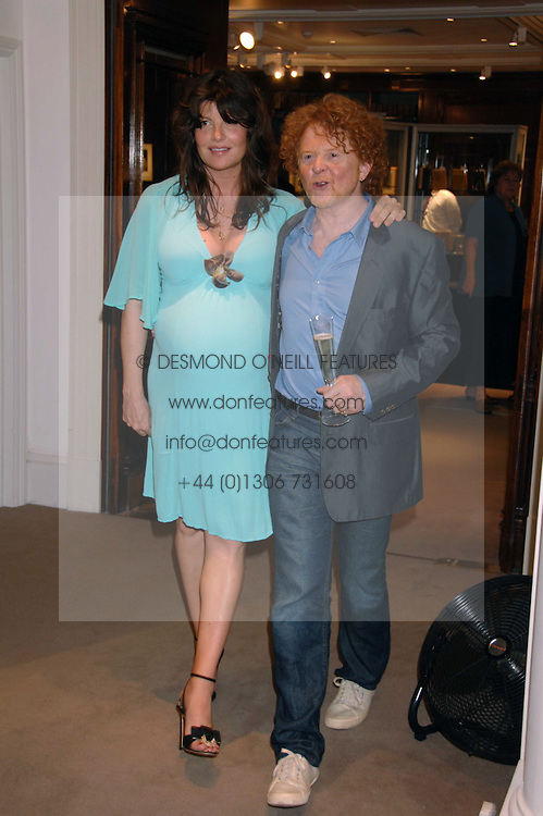 Musician MICK HUCKNALL and GABRIELLA WILKE-WESBERRY at the Sotheby's Summer Party 2007 at their showrooms in New Bond Street, London on 4th June 2007.<br />