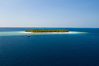 Aerial view of a small island surrounded by turquoise water in North Province, Maldives