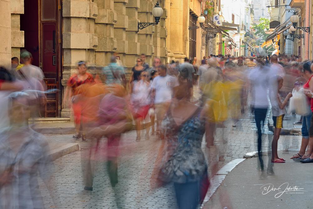 Street photography in Old Havana- the Obispo promenade with pedestrians, La Habana (Havana), Habana, Cuba