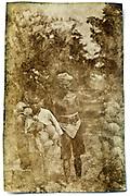 coconut seller with child, Indonesia, Java, Tegaron 1915