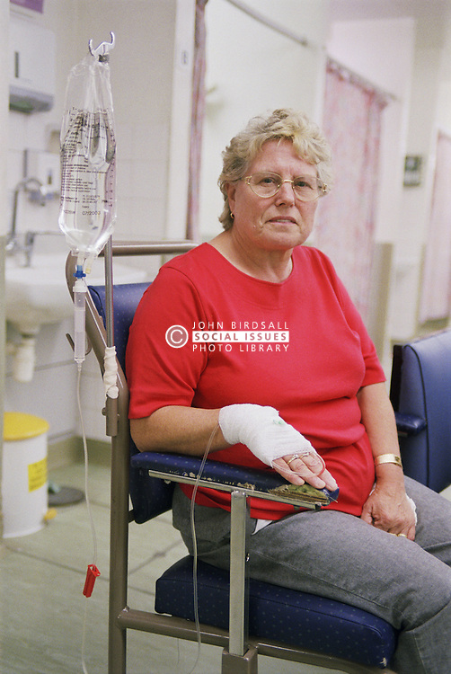 Woman waiting to be treated in accident and emergency department of hospital with drip and bandage on hand,