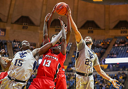 Dec 1, 2018; Morgantown, WV, USA; West Virginia Mountaineers forward Lamont West (15) and Youngstown State Penguins guard Donel Cathcart III (13) and West Virginia Mountaineers forward Esa Ahmad (23) jump for a rebound during the second half at WVU Coliseum. Mandatory Credit: Ben Queen-USA TODAY Sports