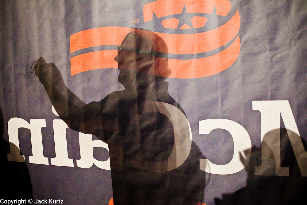 05 MARCH 2010 - PHOENIX, AZ: A supporter of Sen. John McCain (R-AZ) photographs McCain and Sen. Scott Brown (R-MA) after Brown campaigned for McCain at Grand Canyon University in Phoenix. McCain is facing a tough primary battle from former Republican Congressman JD Hayworth. McCain has Scott Brown (R-MA) and Sarah Palin campaigning for him. Both men are courting the Tea Party activists but so far the Tea Party has refused to endorse either candidate.        PHOTO BY JACK KURTZ