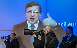 News photographers record the moment as Jose Manuel, Barroso, president of the European Commission, speaks during a press conference, following the conclusion of the EU Summit, at the European Council headquarters in Brussels, Belgium on Friday, Dec. 14, 2012. (Photo © Jock Fistick)
