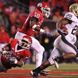 Oct 16, 2009; Piscataway, NJ, USA; Pittsburgh running back Dion Lewis (28) runs past a diving Rutgers cornerback Joe Lefeged (26) and linebacker Antonio Lowery (50) on his way to a 56 yard touchdown run during second half NCAA football action in Pittsburgh's 24-17 victory over Rutgers at Rutgers Stadium.