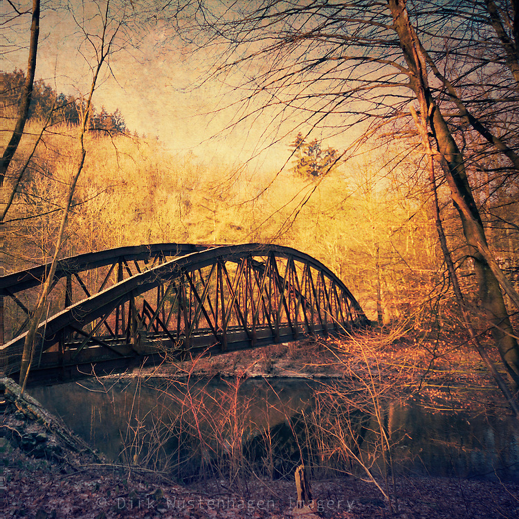 Abandoned railway bridge over river Wupper / Germany. Vintage processing with textures.<br /> Prints: http://society6.com/DirkWuestenhagenImagery/Vintage-Rust-abandoned-bridge