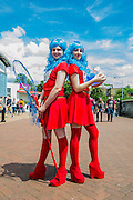 Emily Lowthian and Hannah Galletty (both 17) come as Thing 1 and 2 from Doctor Zeus. London Film and Comic Con 2014, (LFCC), at Earls Court, London, UK.