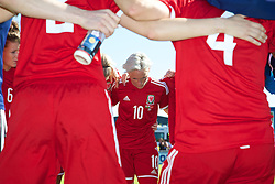 HAVERFORDWEST, WALES - Saturday, June 14, 2014: Wales' captain Jessica Fishlock in a group huddle after the FIFA Women's World Cup Canada 2015 Qualifying Group 6 match against Turkey at the Bridge Meadow Stadium. (Pic by David Rawcliffe/Propaganda)