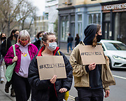 """People marching through the High Streets in Cheltenham holding a sign """"#KILLTHEBILL"""" to protest the introduction of the restriction to the right of protest. 20/02/2021"""