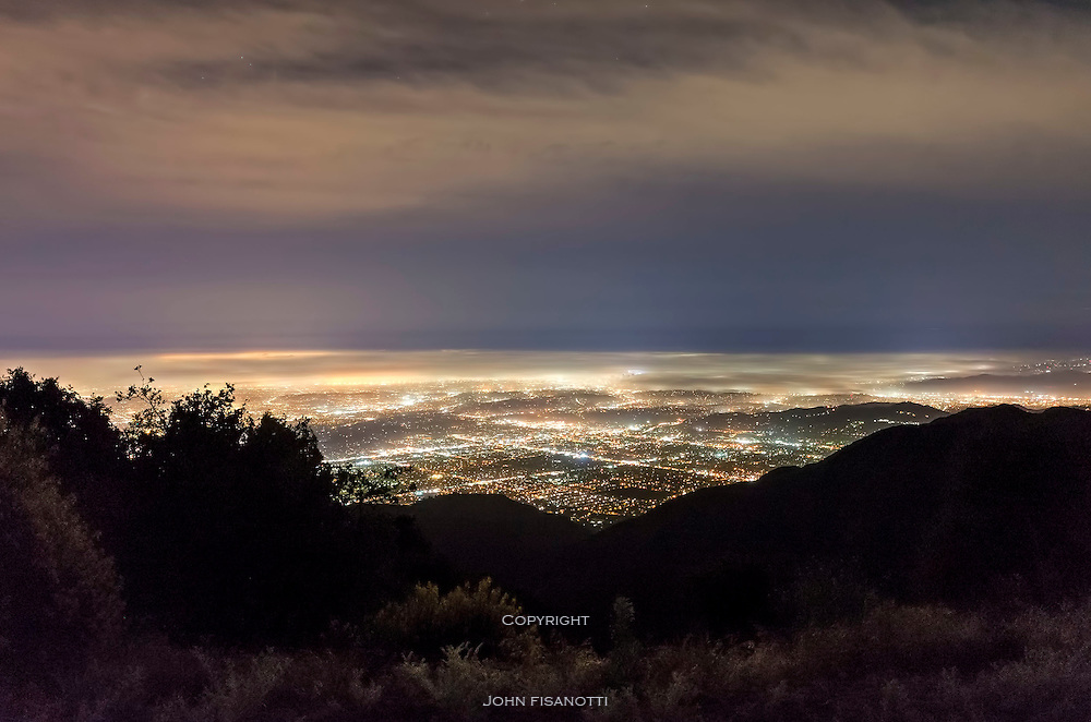 Marine layer of fog blankets Los Angeles at night as seen from Mt. Wilson.