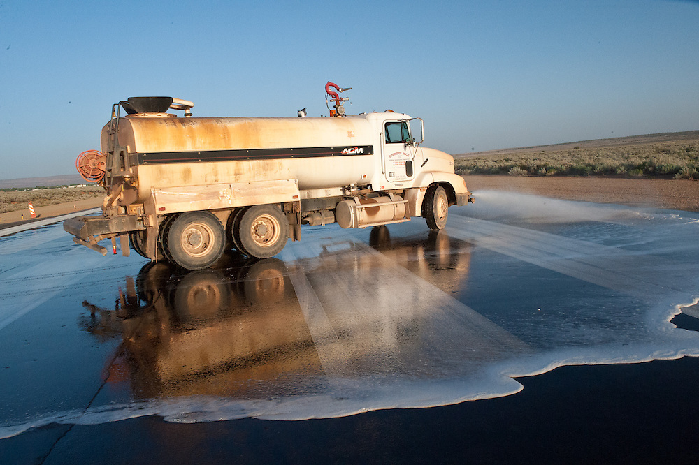 Water truck wetting runway at CCMunicipal Airport,