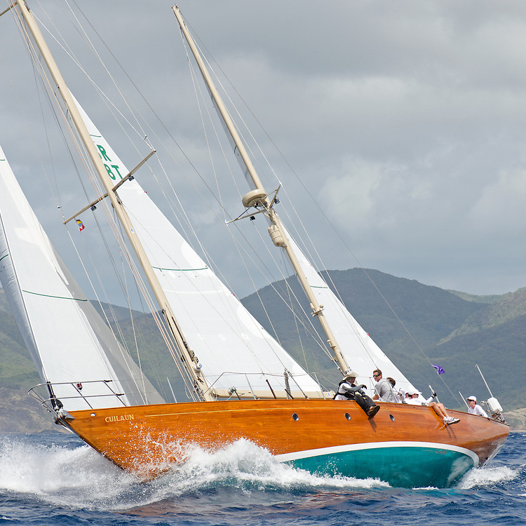 """Cuilaun.<br /> <br /> Back in the 60s, classic yachts, which were gathered in English Harbour Antigua, had begun chartering and the captains and crews challenged each other to a race down to Guadeloupe and back to celebrate the end of the charter season. From this informal race, Antigua Race Week was formalised in 1967, and in those days all of the yachts were classics. As the years grew on, the classic yachts were slowly outnumbered but the faster sleeker modern racing yachts and 24 years later the Classic Class had diminished to a few boats and was abandoned in 1987. However this same year seven classic yachts turned out and were placed in Cruising Class 3 with the bare boats. The class was so unmatched that it was downright dangerous, so Captain Uli Pruesse hosted a meeting onboard Aschanti of Saba with several classic skippers and in 1988 the Antigua Classic Yacht Regatta was born, with seven boats.<br /> <br /> In 1991, Elizabeth Meyer brought her newly refitted Endeavour and Baron Edmond Rothschild brought his 6-meter Spirit of St Kitts and """"CSR"""" became the first Sponsor and inaugurated the Concours d'Elégance. In 1996 we created the """"Spirit of Tradition Class"""", which has now been accepted all over the world, which gives the """"new"""" classics, built along the lines of the old, a chance to sail alongside their sister ships. In 1999 we celebrated the first race between the J class yachts in 60 years. Mount Gay Rum has sponsored the Regatta for many years, and we have recently added Officine Panerai as our first ever Platinum Sponsor.<br /> <br /> The Antigua Classic Yacht Regatta has maintained a steady growth, hosting between 50 and 60 yachts every year and enjoys a wonderful variety of competitors, including traditional craft from the islands, classic ketches, sloops, schooners and yawls making the bulk of the fleet, together with the stunningly beautiful Spirit of Tradition yachts, J Class yachts and Tall Ships."""