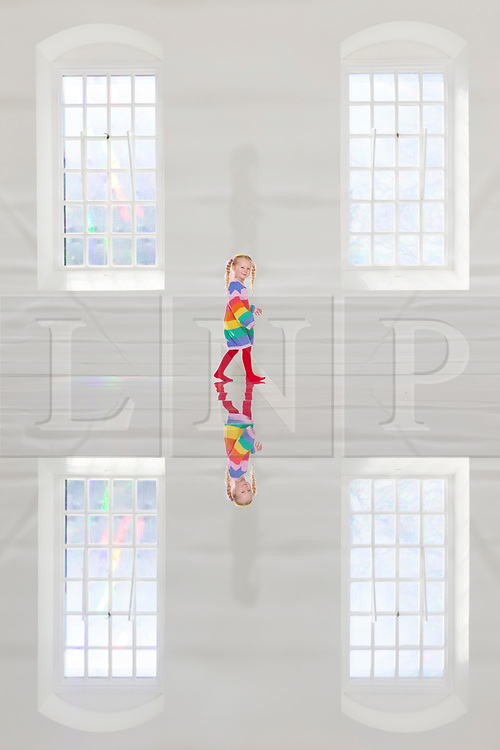 © Licensed to London News Pictures. 29/03/2019. Wakefield UK. 3 year old Scarlet plays on the mirrored floor of the new exhibition by artist Kimsooja called To Breathe that opens tomorrow at the Yorkshire Sculpture Park. Photo credit: Andrew McCaren/LNP