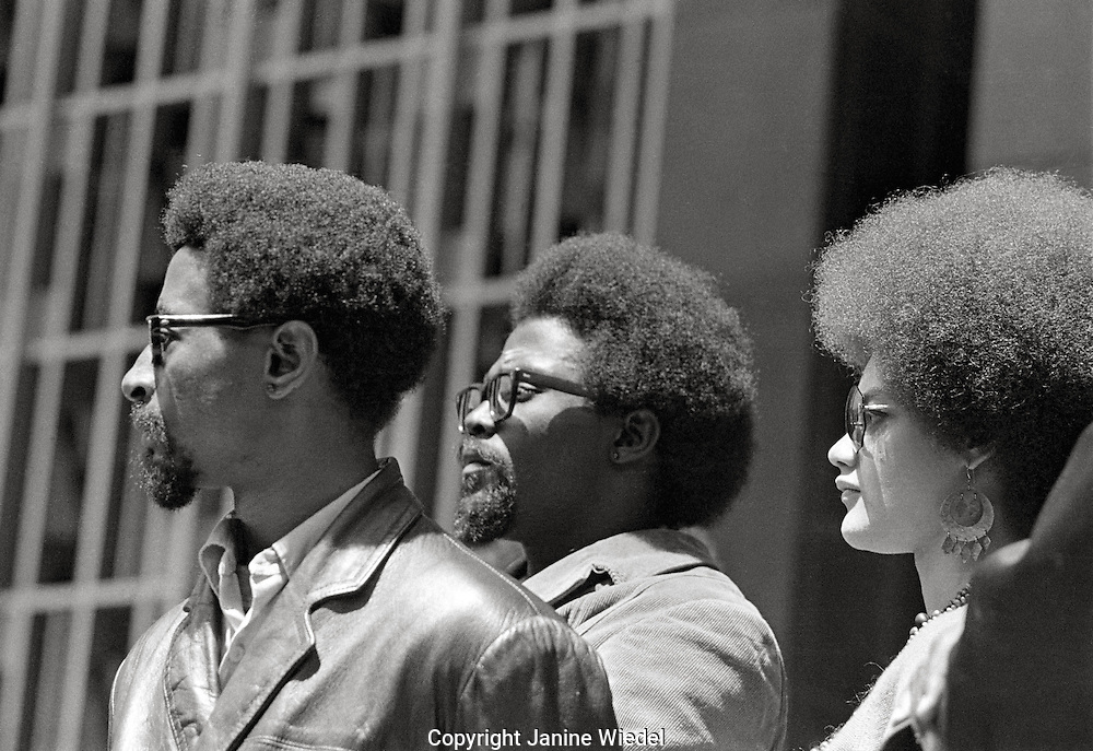 """Kathleen Cleaver with Peco (left) and Frank (center) at """"Free Huey Newton rally"""" at Federal Building in San Francisco, California on Mayday 1969"""