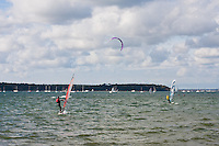 kite surfing and wind surfing in poole harbour in Dorset, England
