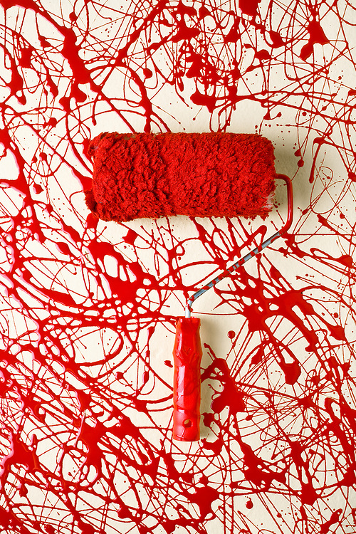 Roller paint brush with red paint