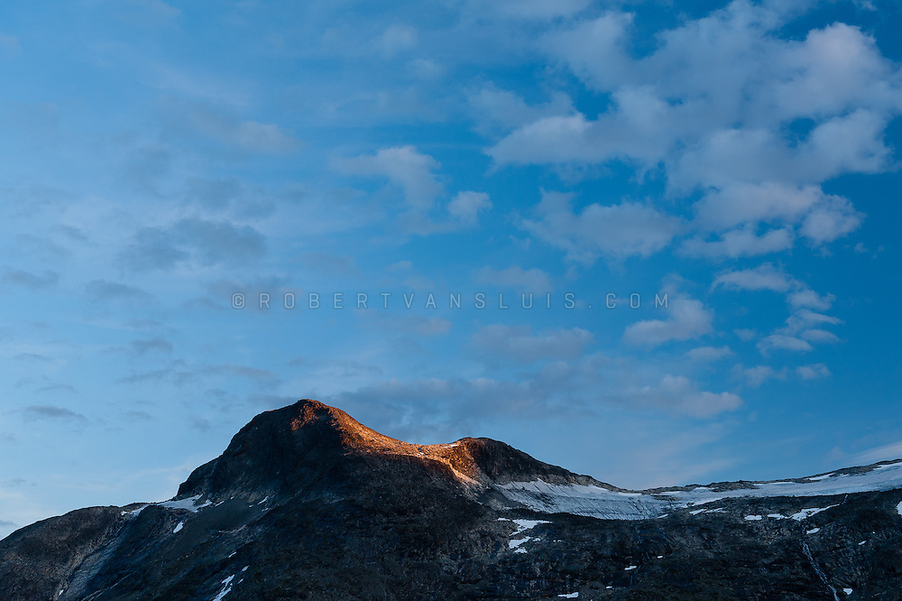 Last light of the day touching the mountains at Jotunheimen National Park, Norway