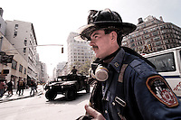 13 September 2001:  NYFD first responder fireman walks along side a government tank near Church Street in lower Manhattan, NY. Area surrounding ground zero where the World Trade Centers WTC once stood less than 36 hours after they fell to the ground in New York City.  Islamic terrorist Osama bin Laden declares The Jihad or Holy War against The United States of America on September 11, 2001. Headline news photos available for editorial use.